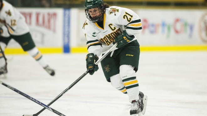 Catamounts forward Amanda Pelkey (21) takes a shot during the women's hockey game between the New Hampshire Wildcats and the Vermont Catamounts at Gutterson Fieldhouse on Friday night Feb. 13, 2015.