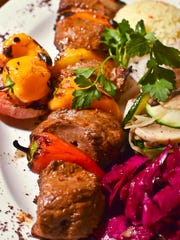 Lamb shish kebab, marinated in a house sauce and grilled