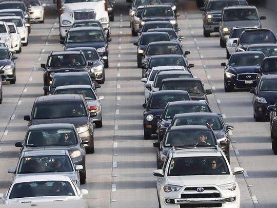 Vehicles pass during the afternoon commute on Highway 101 on April 2, 2018 in Los Angeles, California.
