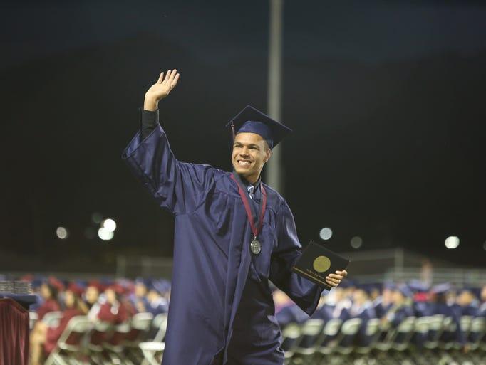 La Quinta High School graduate Levell Mack waves after