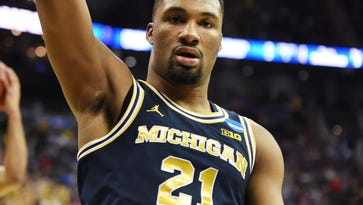 Former Michigan star Zak Irvin lands pro basketball title in the Dominican Republic