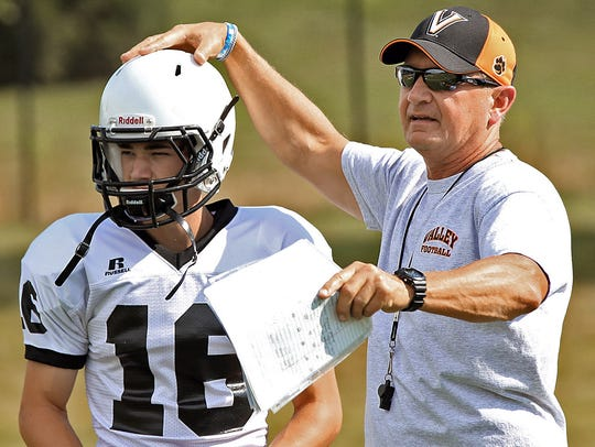 Valley's Gary Swenson, right, has demonstrated ability to win at the highest levels of prep football in Iowa.