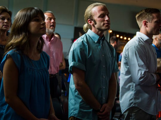 Worshippers sing during a service Sunday, June 4, 2017, at Redemption City Church in Franklin.