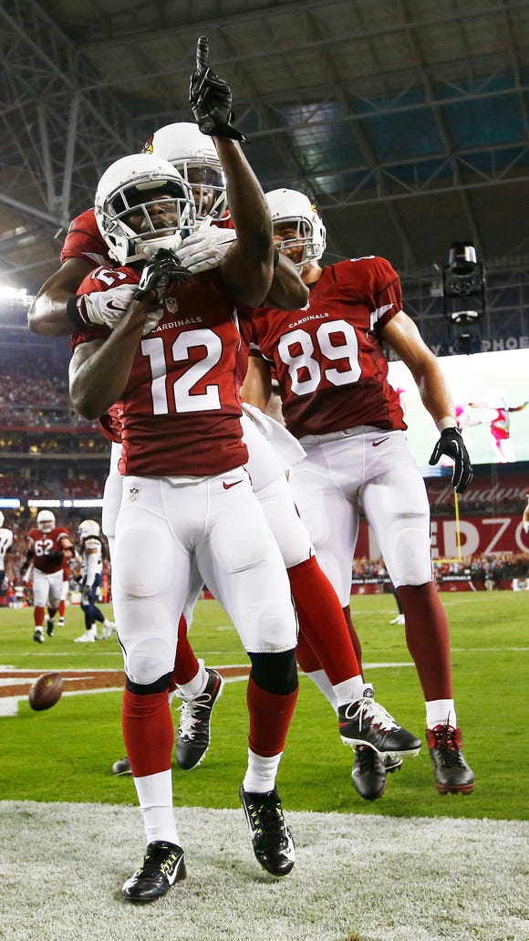 Arizona Cardinals rookiewide receiver John Brown celebrates his game winning touchdown and first NFL TD against San Diego Chargers in the second half during Monday Night Football on Sep. 8, 2014 at University of Phoenix Stadium in Glendale, AZ. (Photo by Rob Schumacher/Arizona Republic)