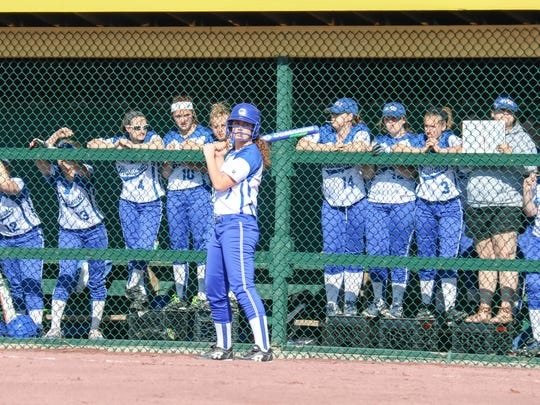 Sarah Harvey waits on deck as the rest of the MVU softball team cheers on the batter during the second inning of play.