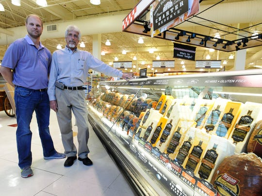 Rob Renfroe, left, and David Locke stand inside Renfroe's Market on Eastchase Parkway.