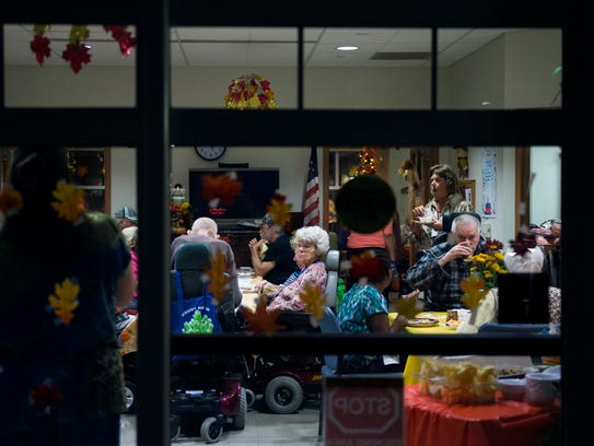 Tenants enjoy an early Thanksgiving dinner organized