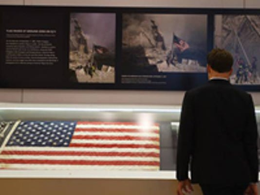 9-11-museum-iconic-flag-returned.jpg