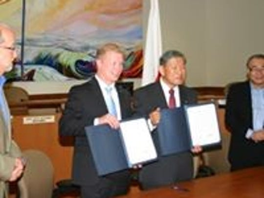 Manitowoc MayorJustin Nickels and former Mayor Hasegawa sign a renewal of sister cities for the 20th year anniversary in Manitowoc.