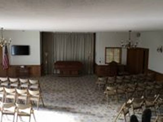 This photo was taken in the chapel at the Peterson Funeral Home before it underwent renovations. It included an empty casket at the front of the room, which has since been moved to create a more welcoming atmosphere.