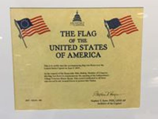 Certificate of authenticity for the American flag displayed