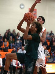 Madison's Kyle Jackson shoots for the basket while playing at Ashland High School on Friday.