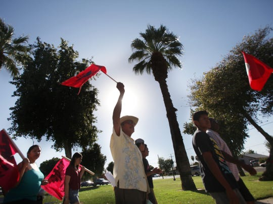 "At center, Jose Juan Muñoz Espitia, 64, a farmer for 40 years. marches symbolically around Veteran's Park in Coachella during the second annual Cesar Chavez ""Price for Justice"" event held in memory of the social activist."