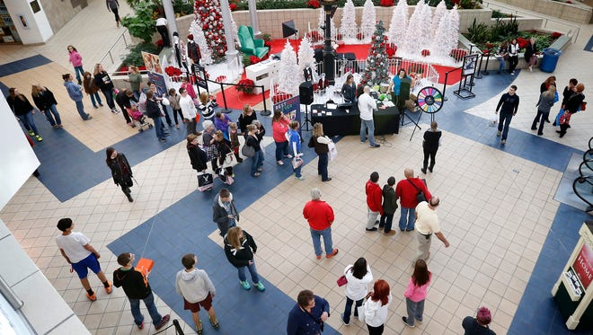 Shoppers flooded the Arnot Mall in Horseheads on Black Friday to grab doorbuster deals and specials. The mall opened to shoppers at 6 a.m.