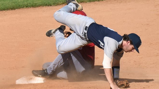 Penn State second baseman Conlin Hughes (2) attempts to tag out Alex Pozo (17) Friday afternoon at Nelson Fernandez Stadium in San Jose de las Lajas, Cuba. The Nittany Lions beat the Hurricanes, 9-3.