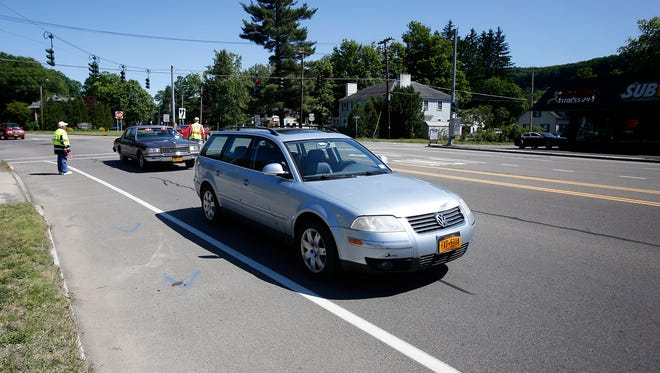 A Volkswagen's hood is dented after hitting a teenage girl Friday afternoon  as she crossed West Water Street from York Avenue in West Elmira.