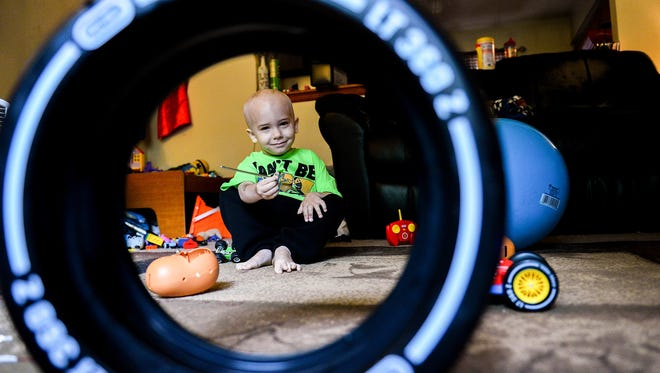 Kaleb Becker, 3, plays with a magic wand in his Eaton Rapids house Friday. Sept. 30, 2016. Kaleb was diagnosed with Acute Leukemia in August, the day of his father's 43rd birthday. The community is planning a fundraiser for the family.