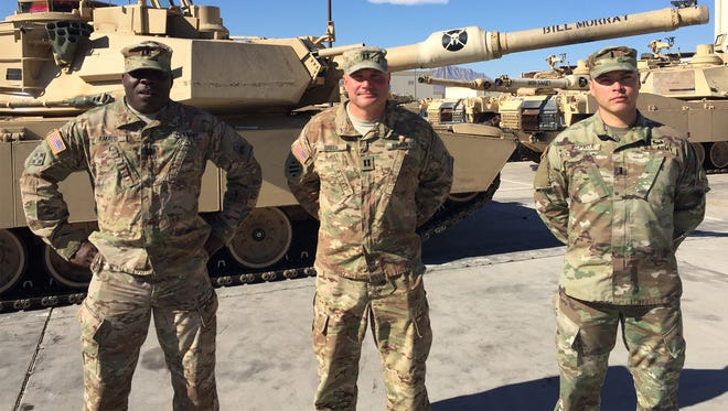 From left, Capt. Franklyn Amato, Capt. Oleg Green and 1st Lt. Jose Espada are all immigrants who serve in key positions with the 1st Battalion, 35th Armored Regiment at Fort Bliss.