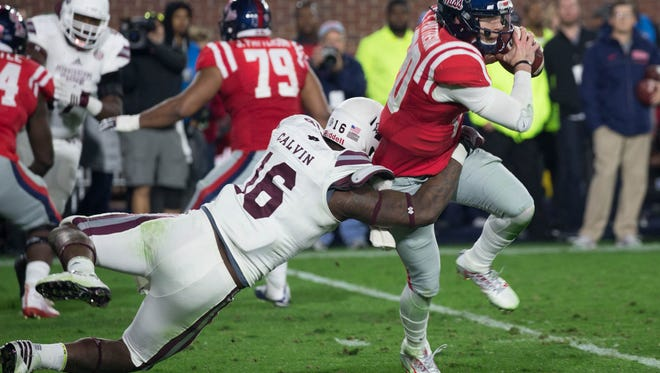 Mississippi State's Johnathan Calvin sacks Shea Patterson for a loss at the 2016 Egg Bowl.