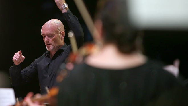Peter Shannon conducts The Jackson Symphony's 37th Starlight Symphony on the grounds of First Presbyterian Church in Jackson in this 2015 file photo.