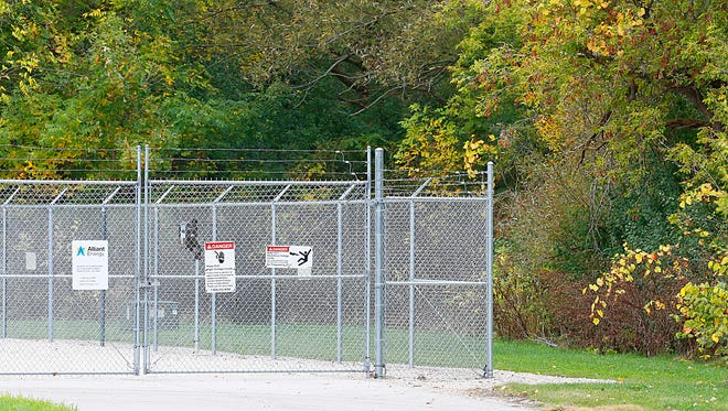 Police discovered a tunnel through the woods behind this Alliant substation on Hickory Street that lead to a makeshift campsite where homeless people were living. Campsites have been cropping up on and off in wooded areas of the community. Wednesday October 11, 2017. Doug Raflik/USA TODAY NETWORK-Wisconsin