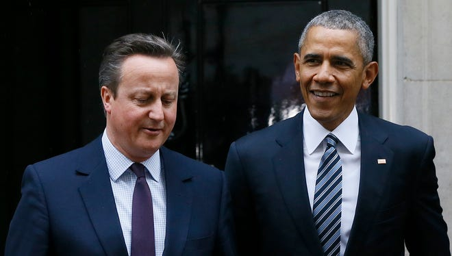 President Obama and Britain's Prime Minister David Cameron walk from 10 Downing Street, London after a meeting Friday.