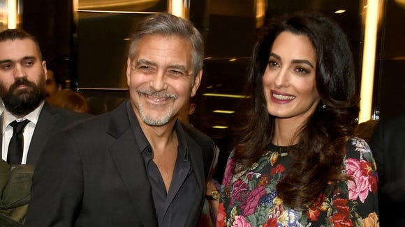George and Amal Clooney, nailing it with the jokes.