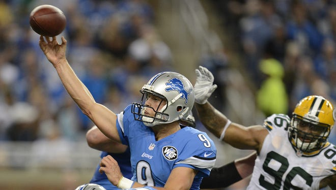 Detroit Lions quarterback Matthew Stafford (9) makes a pass in the third quarter against the Green Bay Packers at Ford Field in Detroit.
