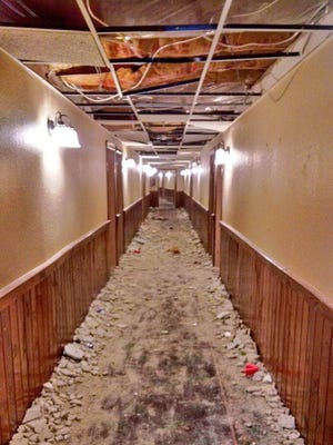 University of Michigan fraternity members are accused of causing significant damage to 45 rooms, including ths hallway pictured here, at Treetops Resort in Dover Township near Gaylord in Michigan.