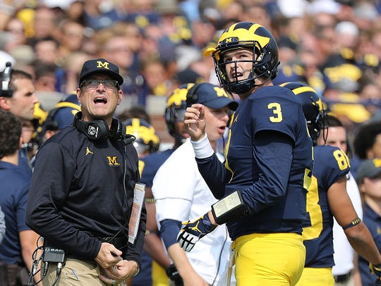 Michigan head football coach Jim Harbaugh will be without