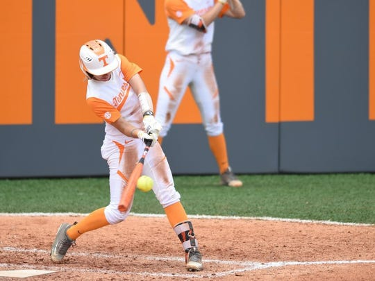 Tennessee's Megan Geer (14) connects for a homerun