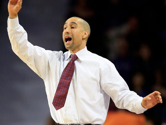 Texas head coach Shaka Smart calls a play during the first half of an NCAA college basketball game against Kansas State in Manhattan, Kan., Monday, Feb. 22, 2016. (AP Photo/Orlin Wagner)