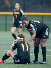 Greece Athena's Kati Sidoti is consoled by Waniya Hudson