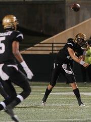 Abilene High quarterback Peyton Killam (12) throws the ball during a 55-0 playoff win over El Paso Americas on Friday, Nov. 18, 2016 at Shotwell Stadium.