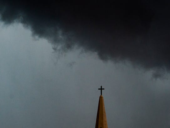 A storm blows into downtown Montgomery, Ala. on Wednesday