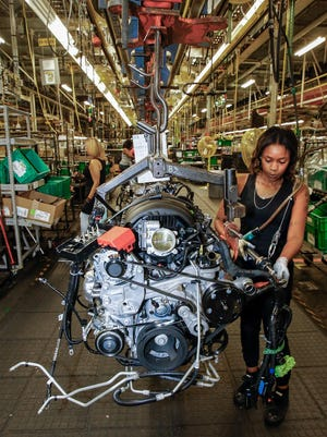 Selena Acezedo (right) work on the assembly line at the General Motors Arlington Assembly Plant Tuesday, July 14, 2015, as GM announces a $1.4 billion investment for upgrades at the plant in Arlington, Texas.