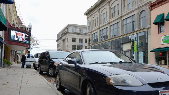 Cars parked on South Eighth Street in downtown Manitowoc.