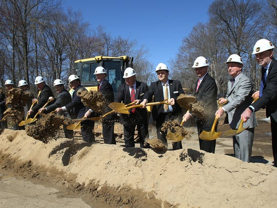 Dignitaries throw a shovel full of dirt for the groundbreaking at the new UPS Technology complex, a 200,000 square foot building sitting on more than 20 acres of land off Cherry Hill Road. March 29, 2016. Parsippany, N.J.