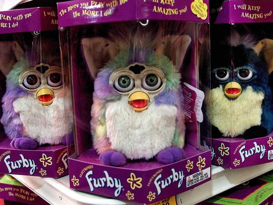 Furby dolls are seen on display at a Toys 'R' Us store in Glendale, Calif., Wednesday, Sept. 29, 1999. They were a hot toy for Christmas 1998.
