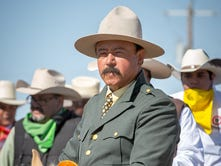 Members of the Cabalgata Binational make their way into Columbus, New Mexico, March 12, 2016, as part of the centennial commemorations of Mexican general Pancho Villa's raid on the United States. An estimated 100 riders participated in the Cabalgata, many of whom rode more than 300 miles from Mexico.