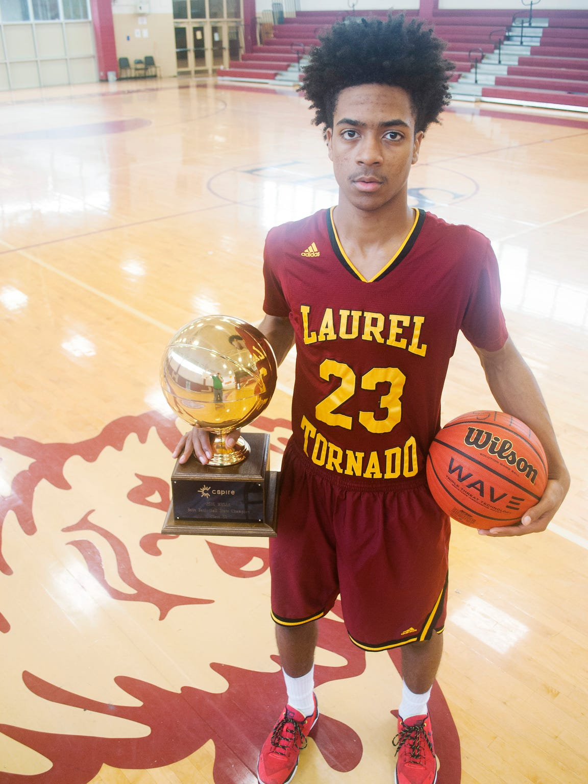 Troymain Crosby poses with Laurel's first boys basketball
