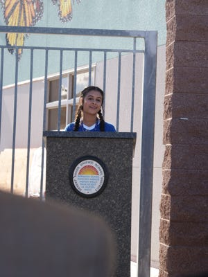 Desert Ridge Academy student government president Lexi Hartley uses the metaphor of a butterfly's life cycle for the changes in the life of a middle school student.
