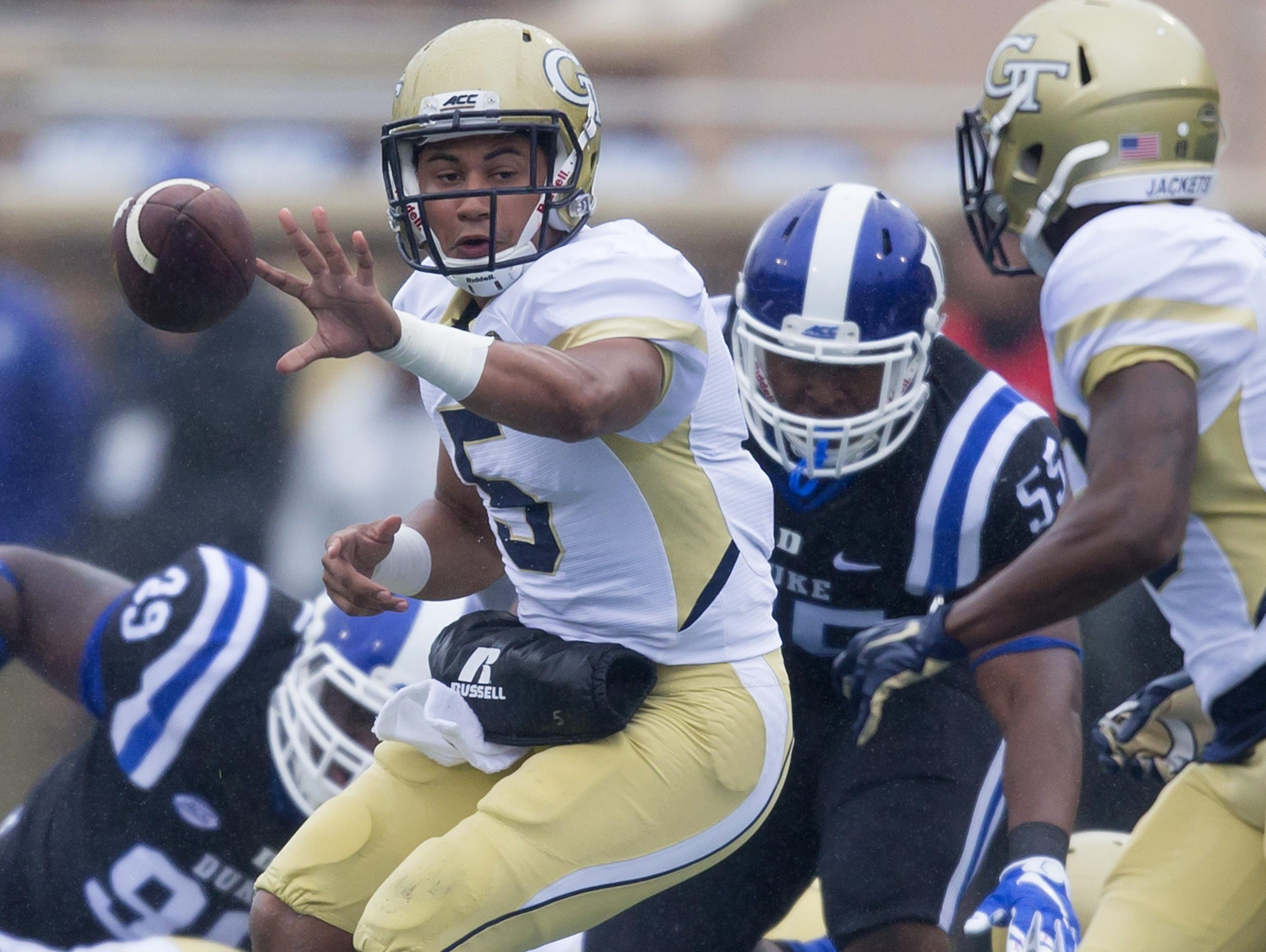 Georgia Tech quarterback Justin Thomas pitches to Clinton Lynch during the first half of an NCAA college football game, in Durham, N.C., Saturday, Sept. 26, 2015. (AP Photo/Rob Brown)