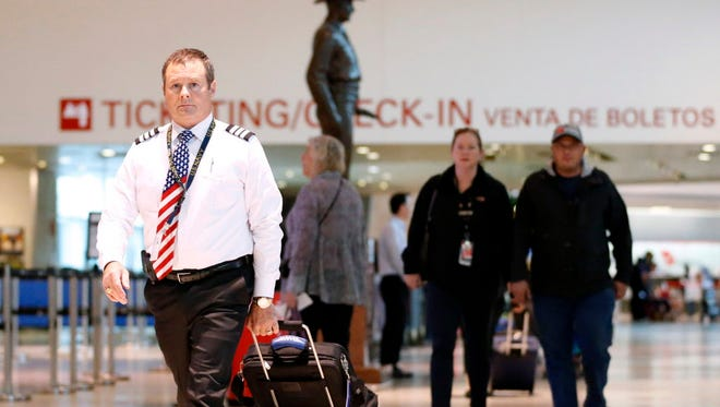 Southwest Airlines first officer Mike Billman arrives for work Wednesday at Dallas Love Field.