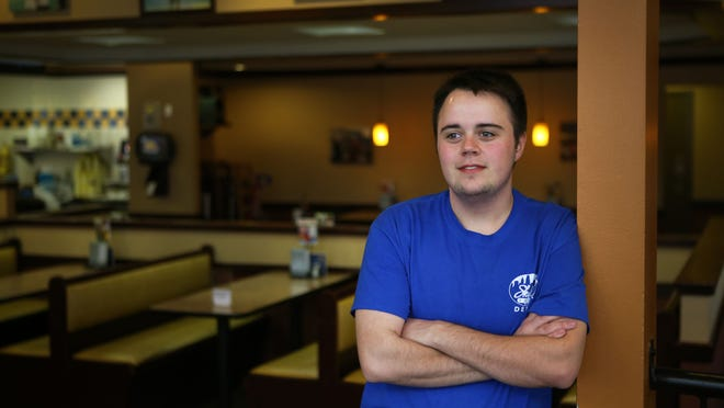 Ashton Dotson, 23, has been working at the Skyline in Delhi for the past three months. He started at the drive-thru window but will start serving.