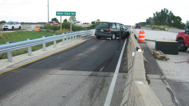 Northbound I-43 near Lakeshore Technical College was closed for about an hour Wednesday after a vehicle sideswiped a semi-truck in a construction zone.