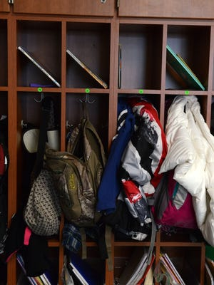 Student books, coats and backpacks are placed in cubbies in Woodmore School. The American Occupational Therapy Association want parents and people to be aware of injuries caused by carrying heavy backpacks.