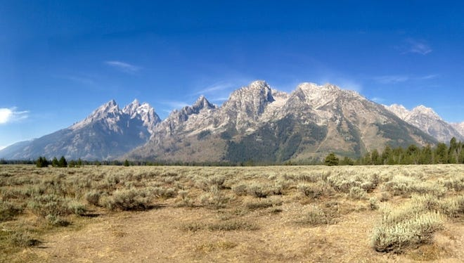 The mountains of Grand Teton National Park loom over the valley floor near Jackson, Wyo. in this 2012 photo. A law professor says a new Wyoming law could restrict the public's ability to document pollution on public lands.