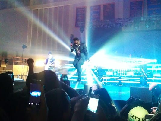 Miguel performs at Morgan State University on Thursday, October 11 in a packed gym.