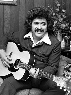 """Freddy Fender gives an interview in the Dot Records office March 27, 1975, during his first visit ever to Nashville. Fender's first single for the label, """"Before the Next Teardrop Falls,"""" is rising on the charts."""